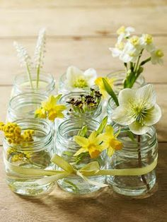 small mason jar centerpieces with yellow/white flowers. could add bits of color too (oranges/pinks/reds).