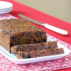 Real Old-Fashioned Fruitcake Recipe Desserts with hot water, cooking spray, all-purpose flour, raisins, dried currants, citron, all-purpose flour, all-purpose flour, whole nutmegs, salt, mace, ground cinnamon, baking soda, ground cloves, butter, sugar, brandy, dark molasses, large eggs