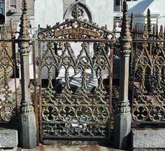 Iron gate in New Orleans cemetery~
