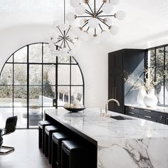 Black and White Kitchen with arched window and integrated door.