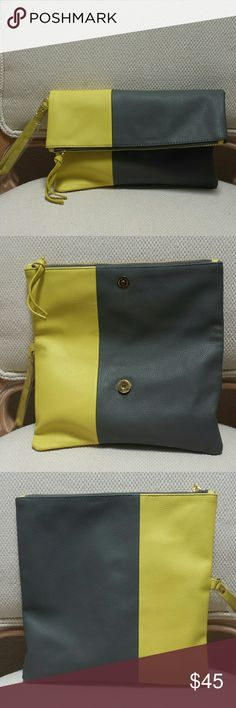 Neiman Marcus Color Block Foldover Clutch This is new.   No trades.   Please submit any offers through the offer option. Neiman Marcus Bags Clutches & Wristlets
