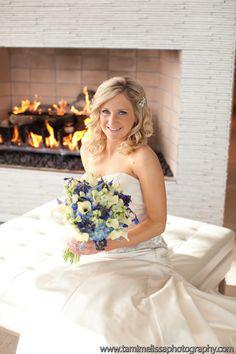beautiful bride with blue and white bridal bouquet, consists of white mini callas, blue delphinium, blue hydrangea