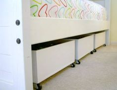 Underbed storage for the girls:         I designed and built these long bins specifically to fit under the girls bunk beds.
