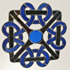 Elaborate Celtic Knot in Royal Blue and Black Stained Glass. $70.00, via Etsy.