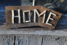 """Handmade Reclaimed Wood """"Home"""" Sign - interior décor for your home, vacation rental or lake house - exterior décor for your barn, garden, greenhouse - gift - wedding / shower décor - photo shoot element (engagement, wedding, family, home) Can be hung, mounted, or affixed to a post (hardware not included)"""