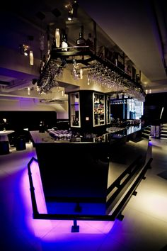 Entourage in SoHo, Hong Kong by Liquid Interiors - club design, bar lounge, bar counter design, purple lighting, black, angular shapes, modern design