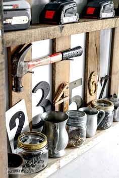 Screw storage in mason jars and cups with funky numbers  / Reclaimed wood wall and junky storage in the workshop - FunkyJunkInteriors.net