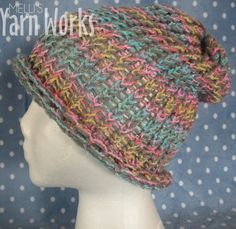 Super soft hat made with two different yarns, a soft grey and a rainbow yarn. The hat is double stranded and handmade by me. The hat is loom knitted. This hat is adult sized and has extra room at the top, which is especially nice for those who have a lot of hair! Look fantastic this winter with t...
