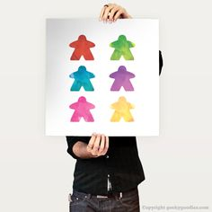 Watercolor Meeple Posters A meeple is a small person-shaped token used in many different board games. Choose your favourite from the colours in the usual board game rainbow and wear it with pride on your next game night.