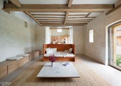 """The farmhouse sitting room, looking towards the stables and the barn. Twenty years after Interior Design Hall of Famer John Pawson collaborated on acclaimed cookbook """"Living and Eating"""" with food writer Annie Bell, he decided to revisit the connection between food and architecture on a more personal level. #InteriorDesign #Homes #LivingRoomSpaces"""