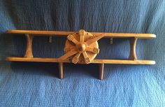 A personal favorite from my Etsy shop https://www.etsy.com/listing/251463786/wood-airplane-shelf