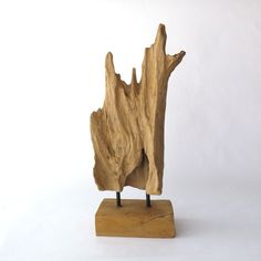 """This driftwood is Nature's artwork! Striking teak driftwood on a stand would look great in any decor from Rustic to Modern. Dimensions: 7 1/2"""" W x 5"""" D x 20"""" H - Free Shipping within the US - Internat"""