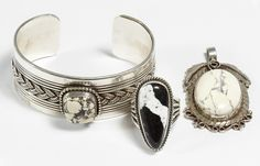 """Lot 525: Navajo Sterling Silver Cuff Bracelet by Peralto; Stamped mark to the interior band; together with a Navajo sterling silver pendant with stamped """"YY"""" mark and a Navajo sterling silver ring by A. Jake; all have stamped sterling silver marks"""