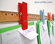 DIY....too cute!  Large wooden clothespin hot glued to a yard stick!
