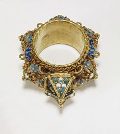Marriage Rings - Ceremonial Jewish wedding ring with fine gold filigree and enamel decoration. The gable compartment, here tiled and with two small windows, is a popular feature on such rings, and may represent the marital home or the temple of Solomon. Four loops around the ring suggest it was designed to be worn as part of a pendant. Although it was doubtless purchased as a rare Renaissance object, it was probably made for the collectors' market in the 19th century. - Marriage rings ...
