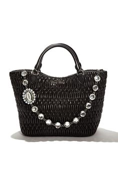 Tote around Miu Miu's most memorable & embellished handbags this holiday season!