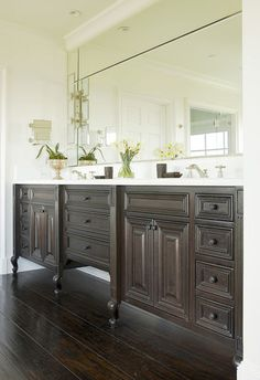 Furniture-style legs: This vanity might look like a piece of furniture, but it's all in the styling. Pilaster-style legs, detailed feet, the varied heights of each cabinet, the flush inset construction: All these elements are critical in making this vanity look and feel like a piece of furniture.