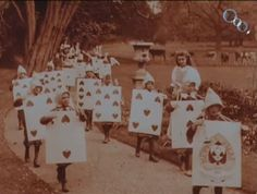 Royal Procession from 1903 Alice in Wonderland movie. The kids are so cute! And check out those cows in the background!