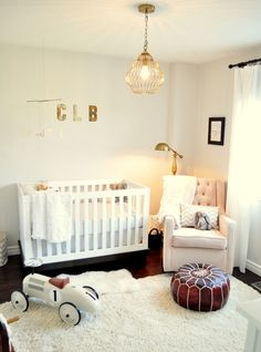 Beautiful nursery, love the warm wood and gold touches. via living beautifully.