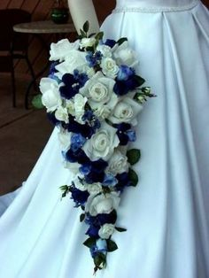 Cascading bridal bouquet I want! but change the royal blue to dark purple and keep the light blue and white as compliments. ♥