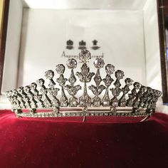 Circa 1900 a variation of the fringe tiara by Asprey and Garrard, multiple pinnacles each with a foliate motif and topped with a circular diamond