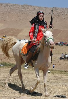 Bakhtiari fighter//The Bakhtiari (Persian: بختیاری) are a southwestern Iranian tribe, and a subgroup of the Lurs. They speak the Bakhtiari dialect, a southwestern Iranian dialect, belonging to the Lurish language. Iranian Women, Persian Culture, Female Soldier, Military Women, Kurdistan, Women In History, People Around The World, World Cultures, Georgia