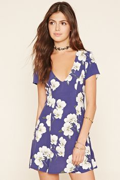 A woven mini dress with a plunging V-neckline, an allover floral print, and short sleeves.