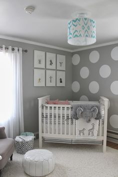 Gray with pops of turquoise and coral. Modern animal pictures in white frames on the wall. #gender #neutral #nursery #ideas