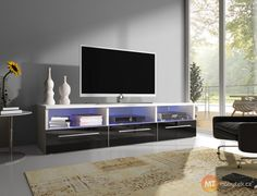 Essence TV Stand for TVs up to Metro Lane Colour: Black Wood Storage, Storage Spaces, Tv Regal, Tv Cabinet Design, Samsung Galaxy Wallpaper, Coffee Table With Storage, Tv Cabinets, Tv Unit, Tvs