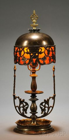 "Pinner: ""Oscar Bach Boudoir Lamp Brass and mica New York, c. 1930 Brass shade with grape and leaf overlay and two faces of Bacchus, over amber liner, held by scroll work arms joined to turned standard, ht. Old Lamps, Antique Lamps, Vintage Lamps, Victorian Lighting, Antique Lighting, Chandelier Lamp, Chandeliers, Ceiling Lamps, Pendant Lamps"