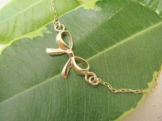 Gold bow bracelet, gold filled bracelet on Etsy, $24.00