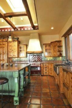 terra cotta -ish tile, granite counter tops and Spanish tile backsplash... Love the floor tile!