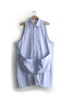 Man's dress shirt to sleeveless top with huge pockets (use the sleeves from the shirt).