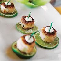 appetizers...mini crabcakes look sitting on a slice of lime