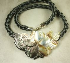 Large mother of pearl flower pendant on hand-braided gray satin cord. By Woojoo