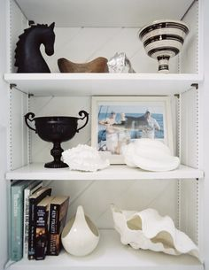 Mostly stuff, little books. #bookshelves