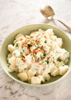 A classic potato salad made epic by pouring French dressing over the potatoes while cooked so it absorbs the flavour. The BEST potato salad I've ever had! www.recipetineats.com