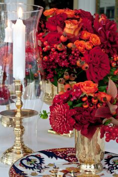 Preparing for Thanksgiving - The last dahlias (from the flower market; mine are long gone!), roses, rose hips, viburnum berries and leaves create a rich mix of autumn tones. One could also add, as I may, bittersweet as an additional textural and seasonal element. -  Carolyne Roehm