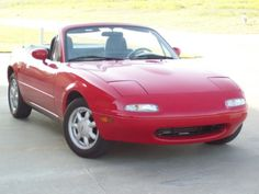1991 Mazda Miata.....my first car in white....great times....looking to someday get a used one and tinker with....fun car!!!