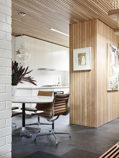 The timber ceiling, slate floor, and timber clad walls are contemporary reinterpretations of details and materials found in modernist homes. Photo – Eve Wilson, Production – Lucy Feagins / The Design Files.