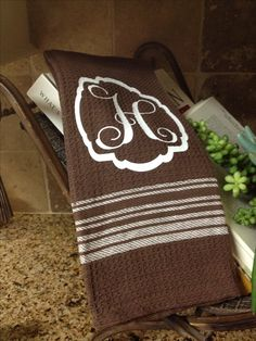 HTV Monogram added to cup towel from dollar tree!