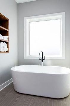 Freestanding Bathtub.. Love the storage built into the wall too