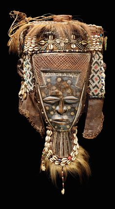 Africa | Mask from the Lele people of DR Congo | Wood, glass beads, cowrie shells, metal, raffia, animal hair