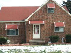 Door and window awnings by Fairview Home Improvement in Fairview Park, Ohio | Curb appeal