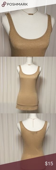 Gold Metallic Tank by Jennifer Lopez Gold Metallic Tank by Jennifer Lopez - all over metallic threading - 73% rayon, 11% nylon, 11% metallic, 5% spandex - great with shorts or jeans - never worn! Jennifer Lopez Tops Tank Tops