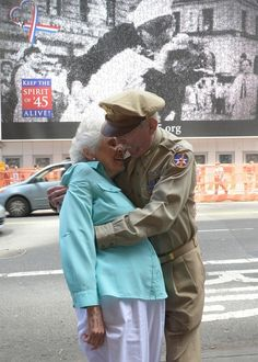 "Fighter Pilot Jerry Yellin and Nurse Gloria Bullard, U.S. Navy, World War ll. Recreating the famous Victor Jorgensen photo, ""The Kiss,"" on VJ-Day, 45 years later!"