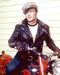 "1953 : Marlon Brando wearing rolled up 501 Levis jeans  Schott Perfecto classic leather jacket in the ""The Wild One"""