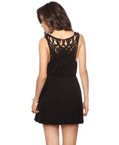 Woven back black dress -- casual yet sophisticated.