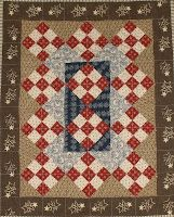 The red really pops and makes the quilt
