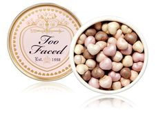 Super-cute powder hearts work like a blush, bronzer, and luminizer all in one! More products for a natural-looking, dewy, and radiant glow: http://blog.womenshealthmag.com/beauty-style-buzz/too-faced-makeup/